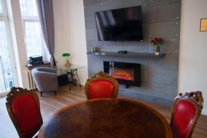 Telewizja i/lub zestaw kina domowego w obiekcie Apartament EC1 Łódź Fabryczna