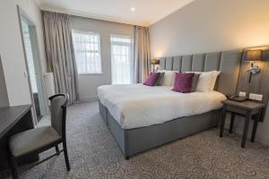 A bed or beds in a room at Hawkstone Park