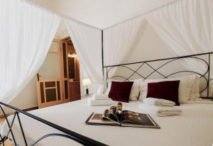 A bed or beds in a room at Hotel Relais 900