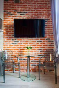 Telewizja i/lub zestaw kina domowego w obiekcie Apartament LOFT Glamour EC1