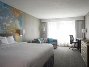 A bed or beds in a room at Courtyard by Marriott Toronto Downtown