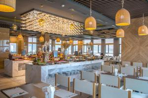 A restaurant or other place to eat at HAIAN Beach Hotel & Spa