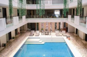 The swimming pool at or close to The Muse Hotel