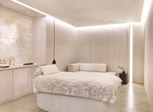 A bed or beds in a room at Park Hyatt Bangkok