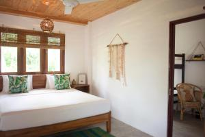 A bed or beds in a room at Salt House