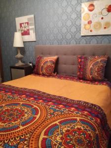Un ou plusieurs lits dans un hébergement de l'établissement B&B Les Hirondelles