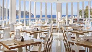 Een restaurant of ander eetgelegenheid bij THB Guya Playa