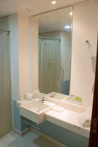 A bathroom at Iguatemi Business & Flat
