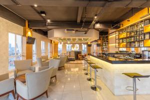 A restaurant or other place to eat at Great Diponegoro Hotel Surabaya