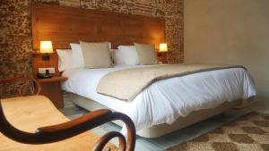 Cama o camas de una habitación en Hotel Casa de las Cuatro Torres