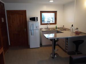 Una cocina o zona de cocina en Cabañas Patagonia Lefun