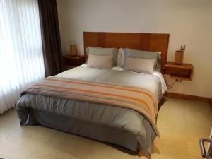 Cama o camas de una habitación en Cabañas Patagonia Lefun