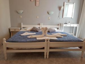 Un ou plusieurs lits dans un hébergement de l'établissement Mark & Joanna Studios