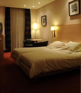 Un ou plusieurs lits dans un hébergement de l'établissement Hotel Escapade