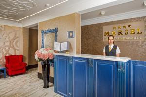 Лобби или стойка регистрации в Отель Марсель