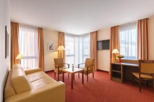 A television and/or entertainment centre at Best Western Hotel Bamberg