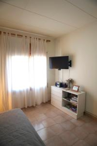 A television and/or entertainment center at Apartment Linyola