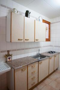 A kitchen or kitchenette at Apartment Linyola