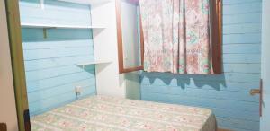 A bed or beds in a room at Villaggio Centro Vacanze De Angelis