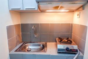 A kitchen or kitchenette at Strategic 1BR Menteng Square Apartment at Central Area By Travelio