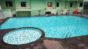 The swimming pool at or near Strategic 1BR Menteng Square Apartment at Central Area By Travelio