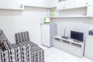 A television and/or entertainment center at Strategic 1BR Menteng Square Apartment at Central Area By Travelio
