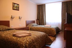 Кровать или кровати в номере Авиаотель