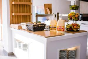 Küche/Küchenzeile in der Unterkunft Apartamentos Playa Ferrera