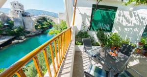 A balcony or terrace at Old Bridge Terrace Apartment