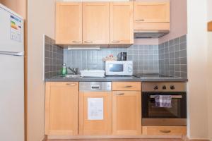 Η κουζίνα ή μικρή κουζίνα στο Mango Aparthotel