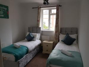 A bed or beds in a room at Vetrelax Ipswich House