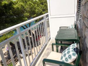 A balcony or terrace at Apartments Pomeštak