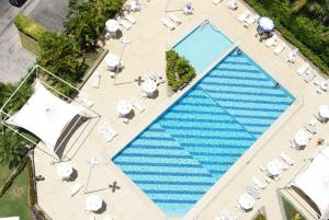 A view of the pool at Fiesta Bahia Hotel or nearby