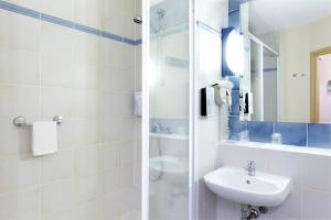 Een badkamer bij Campanile Gent