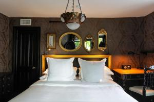 A bed or beds in a room at The Maidstone Hotel