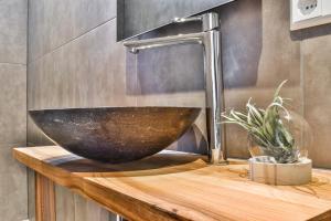 Een badkamer bij Boutique Hotel Koninginn