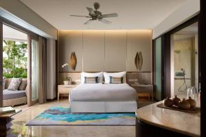 A bed or beds in a room at Conrad Bali