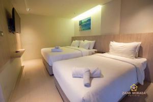 Кровать или кровати в номере Zand Morada Pattaya