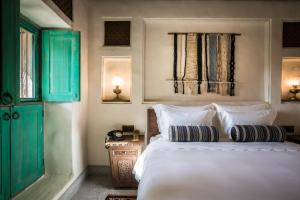 A bed or beds in a room at Al Seef Heritage Hotel Dubai, Curio Collection by Hilton
