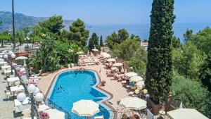 A view of the pool at Hotel Ariston and Palazzo Santa Caterina or nearby
