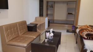 A seating area at Hotel Civic - Gujranwala