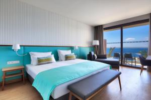 A bed or beds in a room at Sentido Galomar - Adults Only