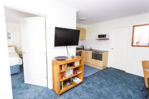 A television and/or entertainment center at Inner City Chippendale Apartment