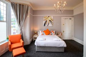 A bed or beds in a room at The Alexander