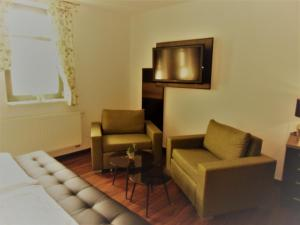 A seating area at Hotel Trendtino