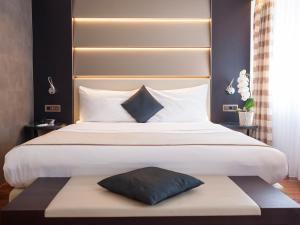 Кровать или кровати в номере Hotel Krone Unterstrass