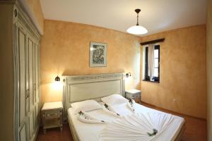 Een bed of bedden in een kamer bij Duni Holiday Village - All Inclusive