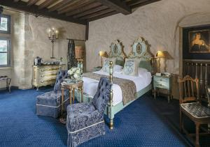 A bed or beds in a room at Chateau de Codignat - Relais & Châteaux
