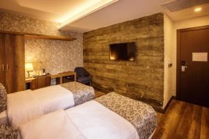 سرير أو أسرّة في غرفة في فندق لايف بوينت