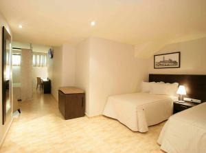 Cama o camas de una habitación en Nastasi Hotel & Spa